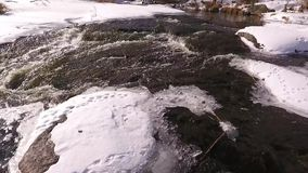 Snowy mountain river stock video footage