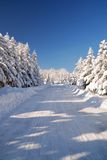 Snowy mountain road. With blue sky Stock Photography