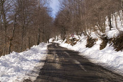 Snowy mountain road Stock Photos