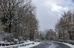 Snowy mountain road cleared with a car. For dangerous streets Royalty Free Stock Images