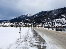 Snowy Mountain Road by the Mountains stock photography