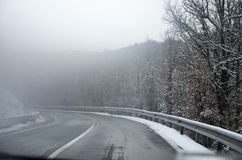 Snowy mountain road snow cleared with trees. That goes in blurry effect Stock Image
