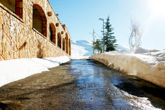 Snowy Mountain Road. Tight mountain road leading to the ski slopes on a sunny day in the middle of winter Stock Photos