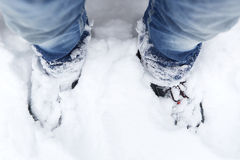 Snowy mountain shoes with blue jeans Royalty Free Stock Image