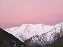 Snowy Mountain at Sunrise. Snowy mountain peak. Photo taken with the purple light of dawn Royalty Free Stock Photo