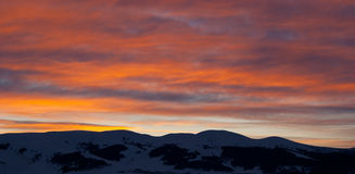 Snowy mountain on sunrise in early morning Royalty Free Stock Photography