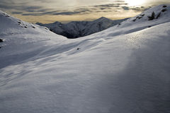 Snowy mountain sunset Stock Image