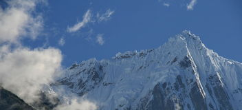 Snowy mountain in Tibet Royalty Free Stock Images