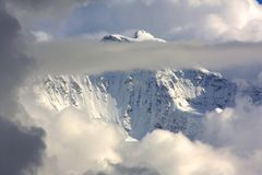 Snowy Mountain top with Clouds Royalty Free Stock Image