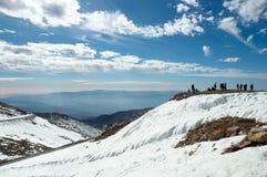 On a snowy mountain top. Royalty Free Stock Photos