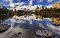 Mountain Landscape Yoho National Park Canadian Rockies. Snowy Mountain Top Reflections and Distant Autumn Panoramic Landscape View above Lake O`Hara in Yoho Royalty Free Stock Image