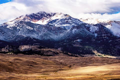 Snowy Mountain Top. Snow covered mountain in Montana stock photography