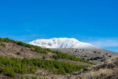 Snowy mountain top on sunny day stock photo