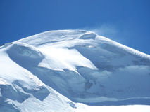 Snowy mountain top in the wind. The snow covered mountain top of the Allalinhorn (4027) near Saas-Fee Switzerland royalty free stock images