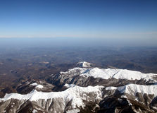 Snowy mountain tops. Aerial view of Italian Alps, clear blue sky stock photography