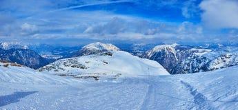 The snowy mountain trail to 5 fingers platform, Dachstein-Krippenstein, Salzkammergut, Austria. Snowy trail on Krippenstein mountain plateau leads to Five stock photography