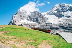 Snowy mountain and train at Jungfrau Eigergletscher in Switzerland