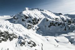 Snowy Mountain Under Blue and White Sky during Daytime Stock Photo
