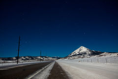 Snowy Mountain under Stars. Mt. Mestas under a starry sky in Huerfano County, Colorado, USA stock images