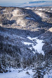 Snowy mountain valley at sunset Royalty Free Stock Photography
