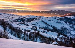 Snowy mountainous countryside at sunrise. Gorgeous landscape with snow covered hills. beautiful scenery in Carpathian mountains Stock Image