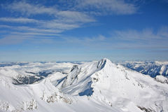 Snowy Mountains. Big Snow Mountain is surrounded by mountains less Stock Image