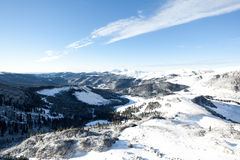 Snowy mountains. Blue sky over snowy white mountains Stock Images