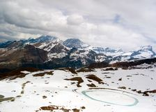 Snowy Mountains. And Cloudy Sky in Switzerland Royalty Free Stock Photos