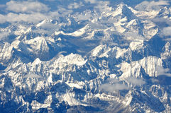 Snowy Mountains. Bird-view of snowy mountains from airplane Royalty Free Stock Photo