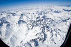 Snowy mountains. Snow-covered mountains as viewed from the plane royalty free stock photo