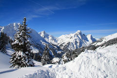 Snowy mountains. Blue sky over snowy white mountains Royalty Free Stock Photos