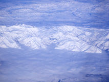 Snowy mountains from above Royalty Free Stock Images