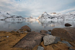 Snowy mountains. From across the lake Stock Photo