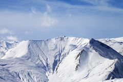 Snowy mountains with avalanches Stock Images