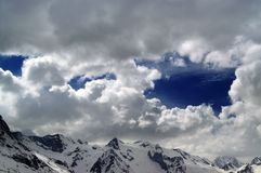 Snowy mountains in beautiful clouds Royalty Free Stock Photo