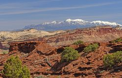 Snowy Mountains Behind a Desert Ridge in Spring Royalty Free Stock Photo