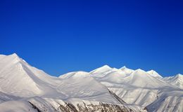 Snowy mountains and blue clear sky Stock Photo