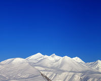 Snowy mountains and blue clear sky  in morning Royalty Free Stock Photos