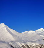 Snowy mountains and blue clear sky at nice morning Stock Photos
