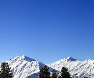 Snowy mountains and blue clear sky at nice sun morning Stock Image
