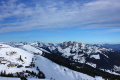 Snowy mountains. And a blue sky Royalty Free Stock Photo