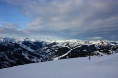 Snowy mountains. And a blue sky Stock Photos