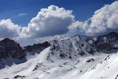 Snowy mountains and blue sky with cloud in sun day Royalty Free Stock Photography