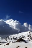 Snowy mountains and blue sky with clouds Royalty Free Stock Photo