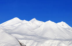 Snowy mountains and blue sky at nice day Stock Photo