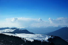 Snowy mountains and blue sky Royalty Free Stock Photography