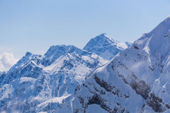 Snowy mountains and blue sky Stock Photo