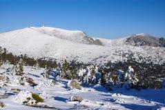 Snowy mountains and bola del mundo in Navacerrada, Madrid, Spain Royalty Free Stock Image