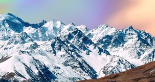 Snowy mountains with bright and unusual clouds