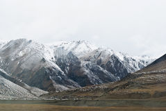 Snowy mountains in clouds in Tibet panorama view Stock Photo